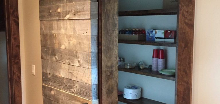 Rustic sliding alder barn door, kitchen cabinet